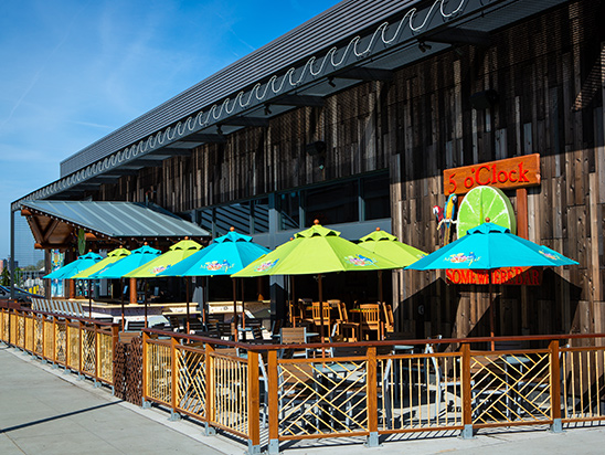 Tables with chairs under umbrellas in Patio